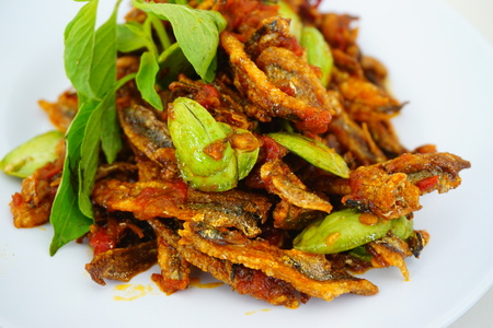 pete: Malaysian dish dried anchovy with stink bean in hot chili sauce or locally known as sambal petai ikan bilis in white bowl Stock Photo