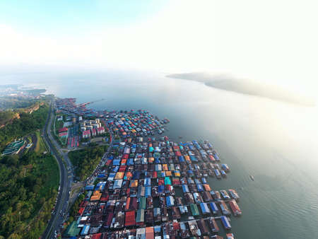 aerial drone image of local water village houses at Kg. Sim Sim water village Sandakan City, Sabah, Malaysia. Sandakan once known as Little Hong Kong of Borneo. Stock Photo