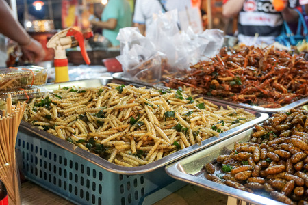 Exotic food one of the extreme Asian tourisme attraction. Night market in Bangkok Thailand. Stok Fotoğraf