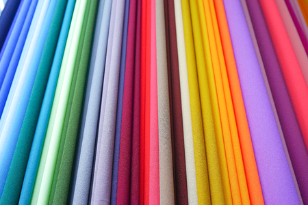 color: Repeated colours. Colourful fabric on display at market in Malaysia.
