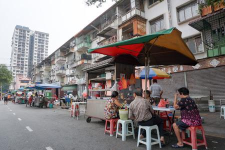 Kuala Lumpur, Malaysia  October 17, 2015. Old folks having drink at the stall, street hawker  coffee shop at Chow Kit Road, Kuala Lumpur, Malaysia.