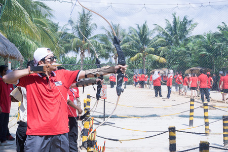 recurve: Selangor, Malaysia - October 31, 2015 – People enjoy playing archery in carnival open day in summer. Editorial