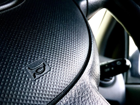 Automotive and car safety concept. View of car panel dashboard and steering wheel. Stok Fotoğraf