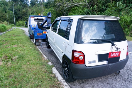Pahang, Malaysia. Nov 10, 2015. Car breakdown with towing truck. It is importance to have some assurance in case of breakdown and for fast assistance. Editöryel