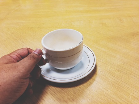 Shot of empty cup. Daily morning ritual, having cup of coffee. Nothing make sense before having a coffee. 