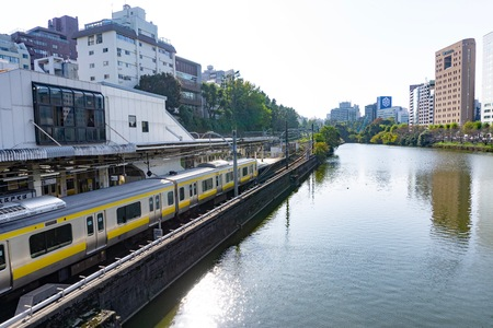 View of train station in Tokyo. Rail is the primary mode of transport in Tokyo. Greater Tokyo has the most extensive urban railway network and the most used in the world with 40 million passengers in the metro area daily, out of a metro population of 36 m