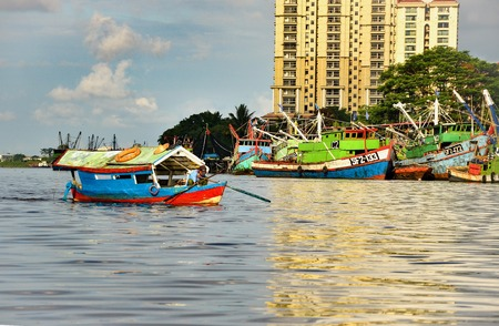 Shot local boat operator in Kuching, Sarawak. Boat, also known as sampan by local, is one of the important transportation especially in rural area. 