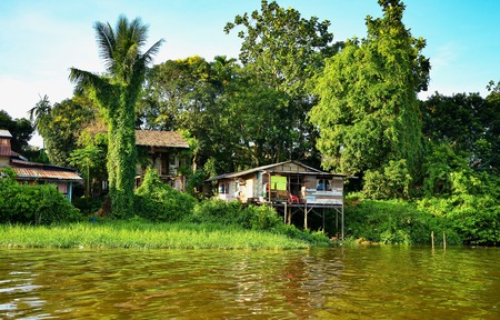 Houses at riverbank for local people in rural area. Common scene at fisherman villages. 