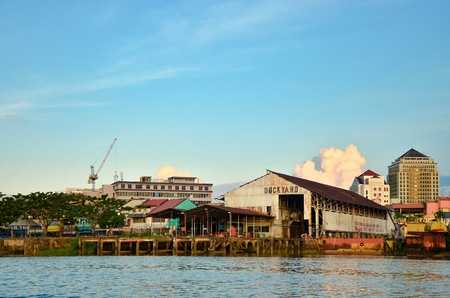Shot of conventional dockyard along side of the river in Sarawak. Common scene for small business entity and local fisherman using the dockyard.  Editöryel