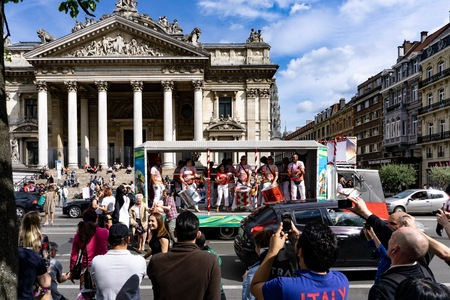Local people and tourist celeberating and having party during a day on the street in Brussels, Belgium. 