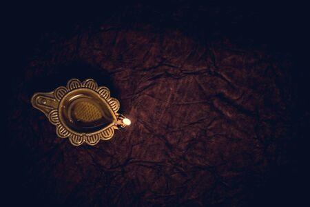 Diwali traditional diya lamp on floor background flat lay Stockfoto