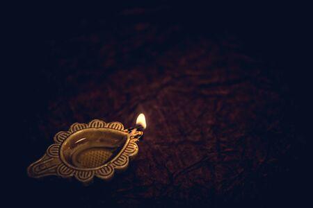 Diwali traditional Diya lamp on floor background
