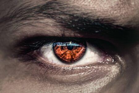 dark evil eyes with orange pupil