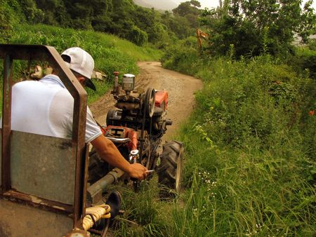 dirtroad: korean farmer smokes on his tractor