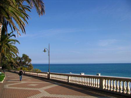 asian girl walks alond the mediterranean sea Stock Photo - 4392587