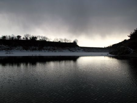 religious service: frozen lake in sunset