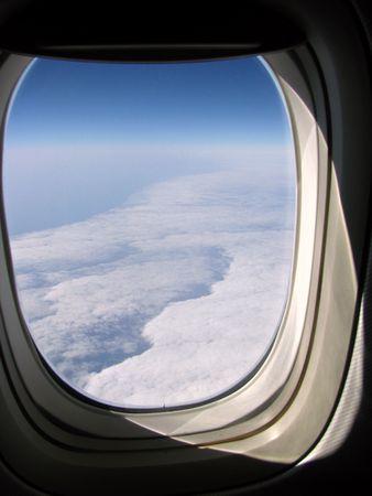 sky seen through the airplane window photo