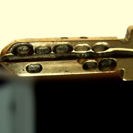 a gold-colored key photo