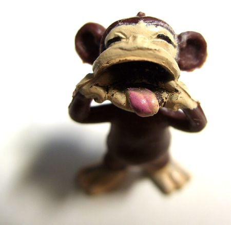 curio: a toy monkey standing with his tongue out Stock Photo