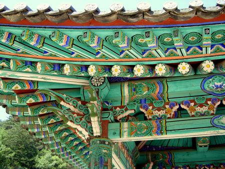 details of a roof with beautiful color of a temple in south korea photo