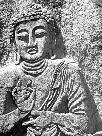 giant buddha carved on a rock in south korea photo