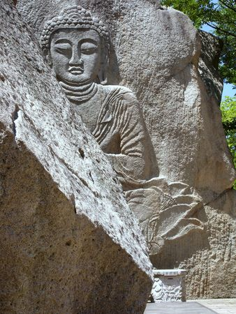 sanctification: giant buddha carved on a rock in south korea Stock Photo