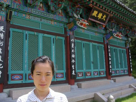 an asian woman in front of a buddhist temple Stock Photo - 5201138