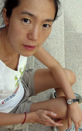 asian girl sitting on the stairs photo