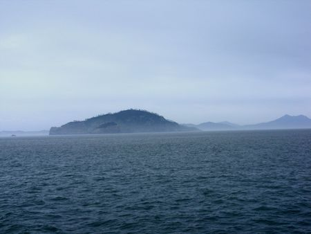 tiny deserted islands in the middle of the ocean photo