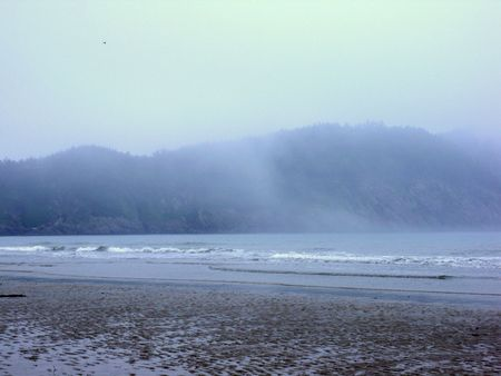 mist over the mountain in the sea photo