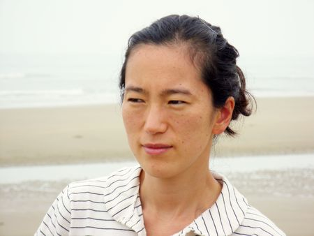 portrait of an asian woman with striped t-shirts photo