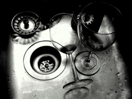 mess in the kitchen sink and wine glasses Stock Photo - 7533357
