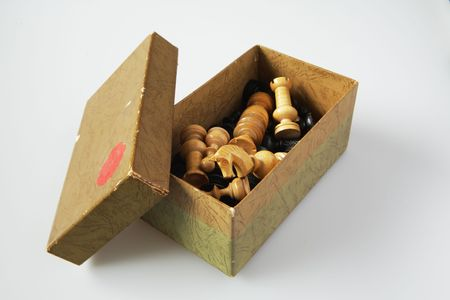 Vintage chess figures in a worn box