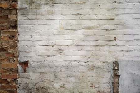 grungy brickwall with white old plasterwork