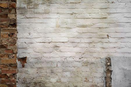 plasterwork: grungy brickwall with white old plasterwork