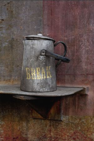 Conceptual still life: break, industrial environment, workingmans steel plate coffe pot, with caption Stock Photo - 5091051