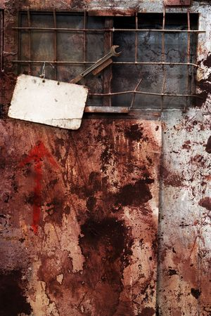 Extreme grungy still life: Worn sign in an abandoned site, rusted and dirty, free copy space Stock Photo - 5099691