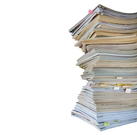 stack of worn magazines and jounals