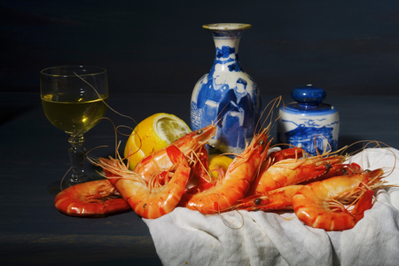 food still: vintage style food still life with king prawns and a glass of white wine