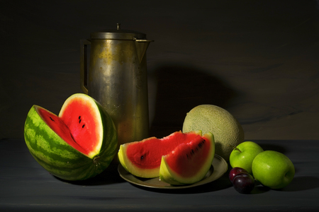 food still: vintage style food still life with watermelons and other fruit