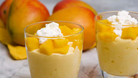 Mango Mousse cream and gelatin and mix with flavourings and topped with fruits