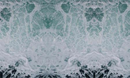 wave smashing foam spray sea water waves background white blue