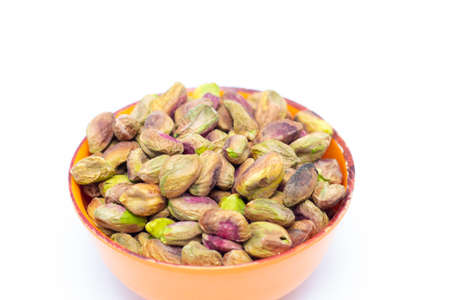 Fresh raw peeled pistachios isolated on white background