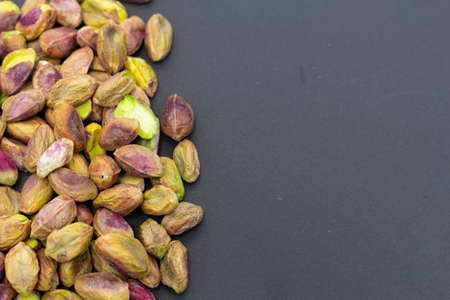 Fresh raw peeled pistachios isolated on Black background