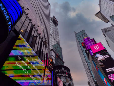 Times Square New York city USA, one of the world's most visited tourist attractions showing skyscrapers and bright illuminated billboards Sajtókép