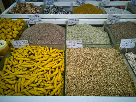 Wide variety of typical Indian and Arabic spices, displayed in a street market stall in Souk Waqif Doha , Qatar.