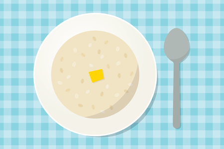 dietology: Oatmeal porridge with a piece of butter in a plate with spoon. Healthy breakfast