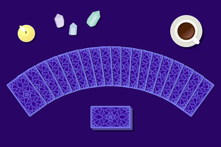 Tarot cards by reverse side laying in a semicircle on fortuneteller table. Above view. Witch working place