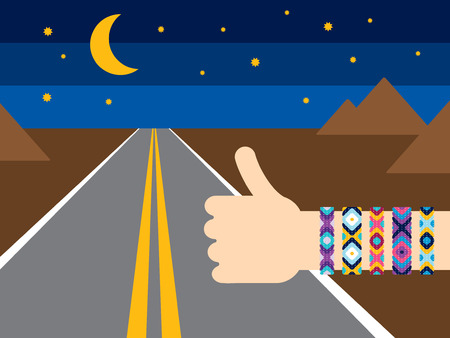 night road: Hand with hippy friendship bracelets hitchhiking on the night road