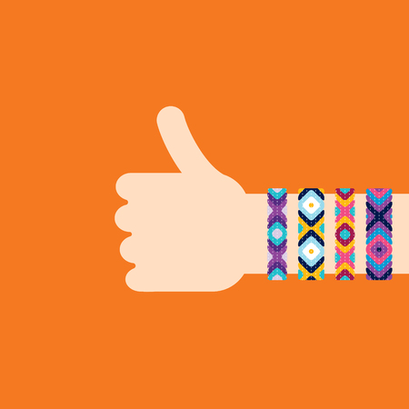 dyi: Hitchhiking hand with hippy friendship bracelets. Thumb up sign Stock Photo